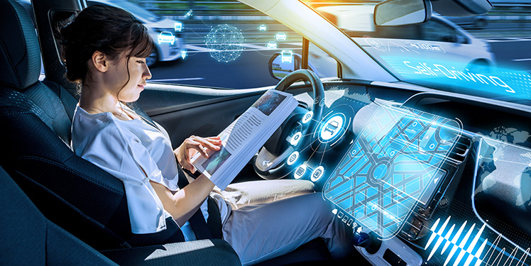 young woman reading a magazine in a autonomous car. driverless car. self-driving vehicle. heads up display. automotive technology.Fraunhofer-Institut IESE